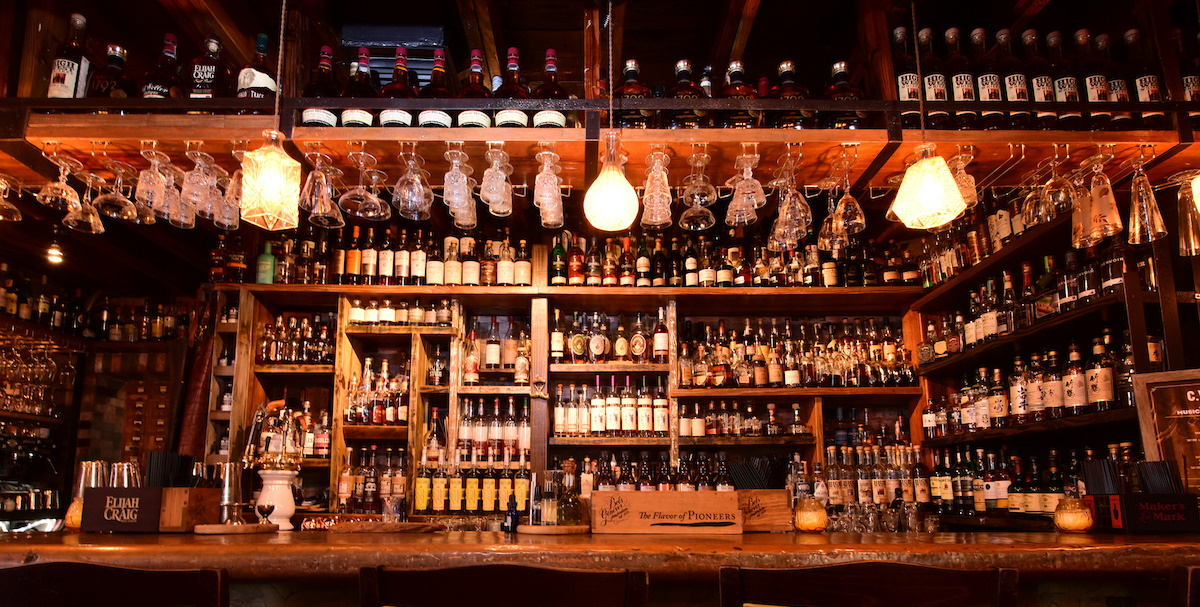 A bar jam packed with bottles of whiskey