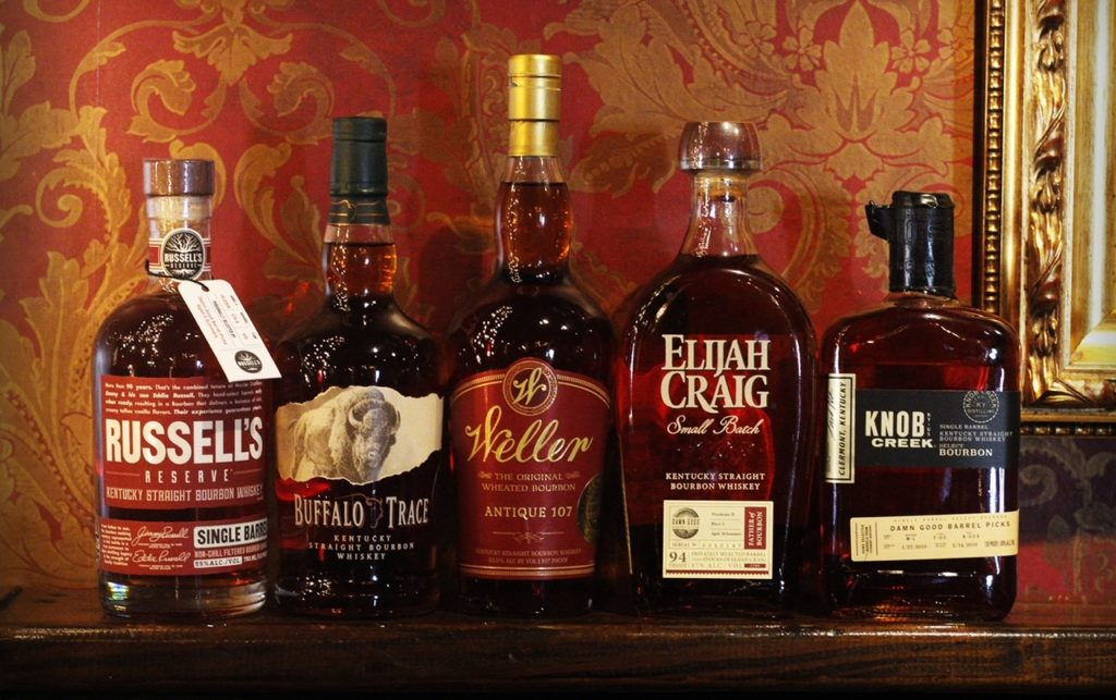 A row of Damn Good Hospitality Barrel Pick Bourbons