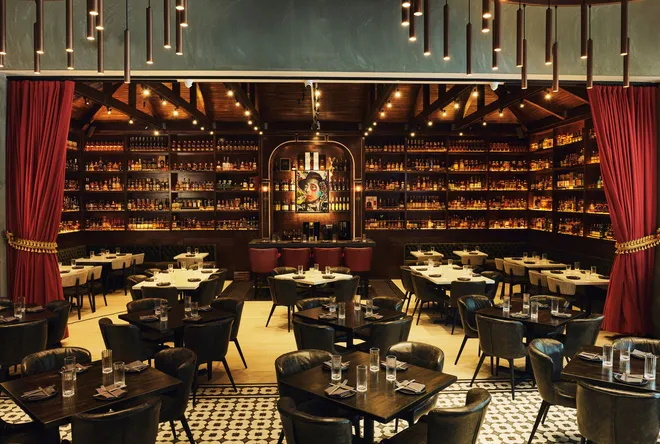 Interior of Warren Delray, showing main dining room and the whiskey library.